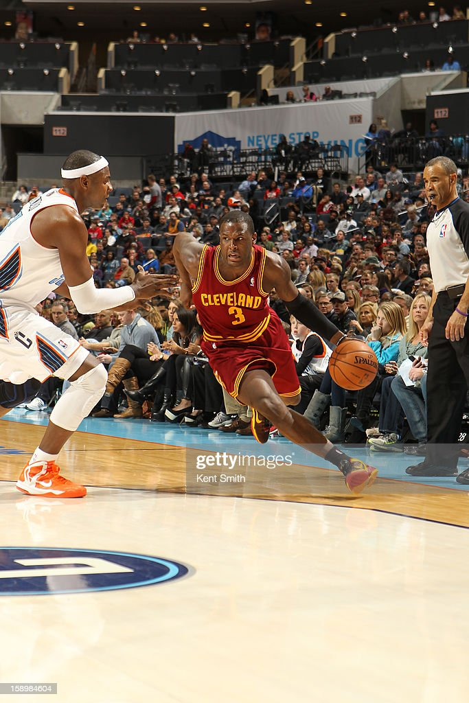 Dion Waiters #3 of the Cleveland Cavaliers drives against Brendan Haywood #33 of the Charlotte Bobcats at the Time Warner Cable Arena on January 4, 2013 in Charlotte, North Carolina.