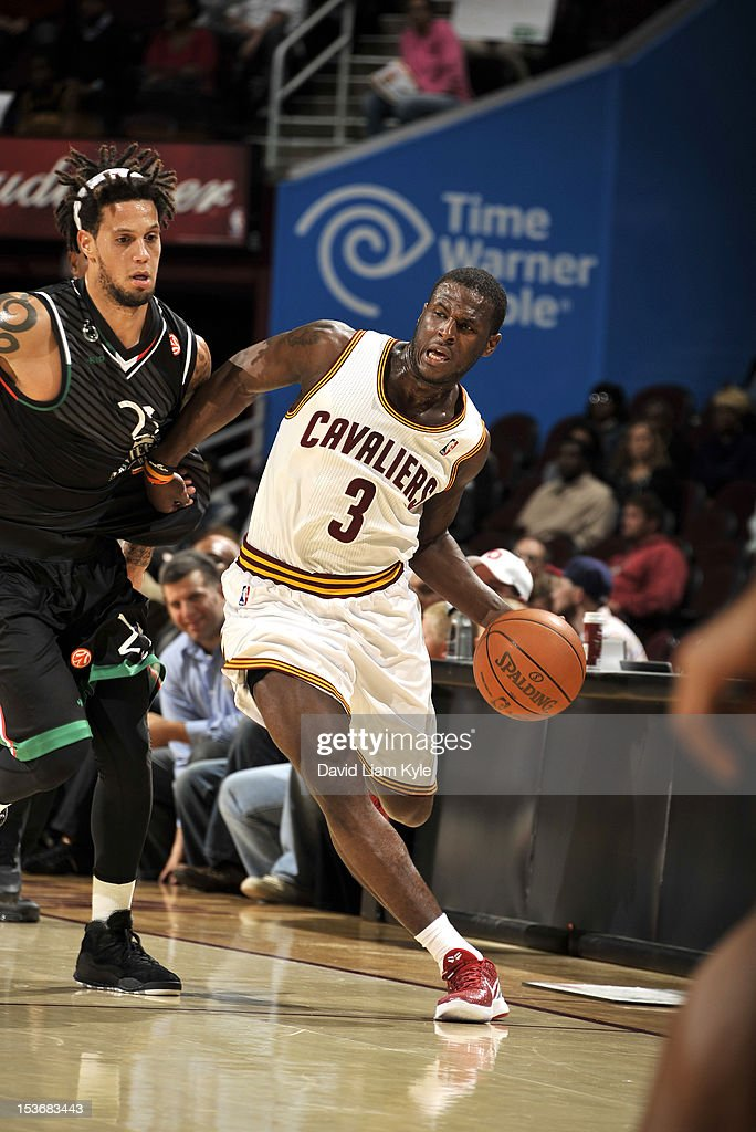 <a gi-track='captionPersonalityLinkClicked' href=/galleries/search?phrase=Dion+Waiters&family=editorial&specificpeople=6902921 ng-click='$event.stopPropagation()'>Dion Waiters</a> #3 of the Cleveland Cavaliers drives against Daniel Hackett #23 of the Montepaschi Siena during the game between the Montepaschi Siena and the Cleveland Cavaliers at The Quicken Loans Arena on October 8, 2012 in Cleveland, Ohio.