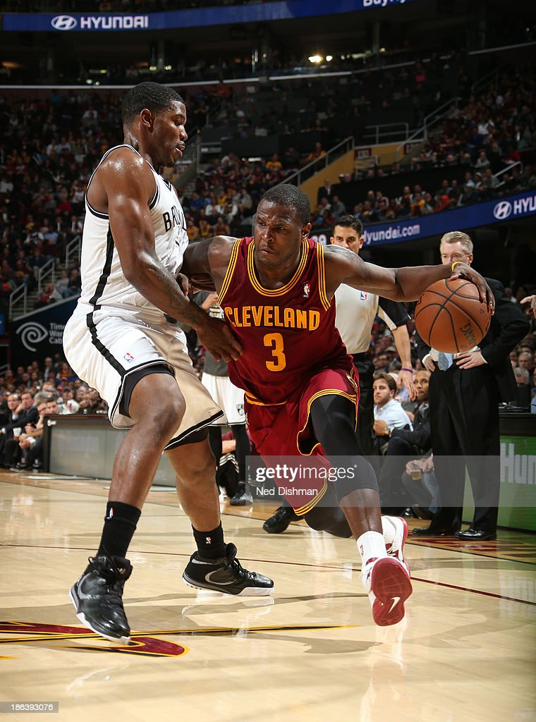 <a gi-track='captionPersonalityLinkClicked' href=/galleries/search?phrase=Dion+Waiters&family=editorial&specificpeople=6902921 ng-click='$event.stopPropagation()'>Dion Waiters</a> #3 of the Cleveland Cavaliers drives against <a gi-track='captionPersonalityLinkClicked' href=/galleries/search?phrase=Joe+Johnson+-+Basketball+Player&family=editorial&specificpeople=201652 ng-click='$event.stopPropagation()'>Joe Johnson</a> #7 of the Brooklyn Nets during a game at the Quicken Loans Arena on October 30, 2013 in Cleveland, Ohio.
