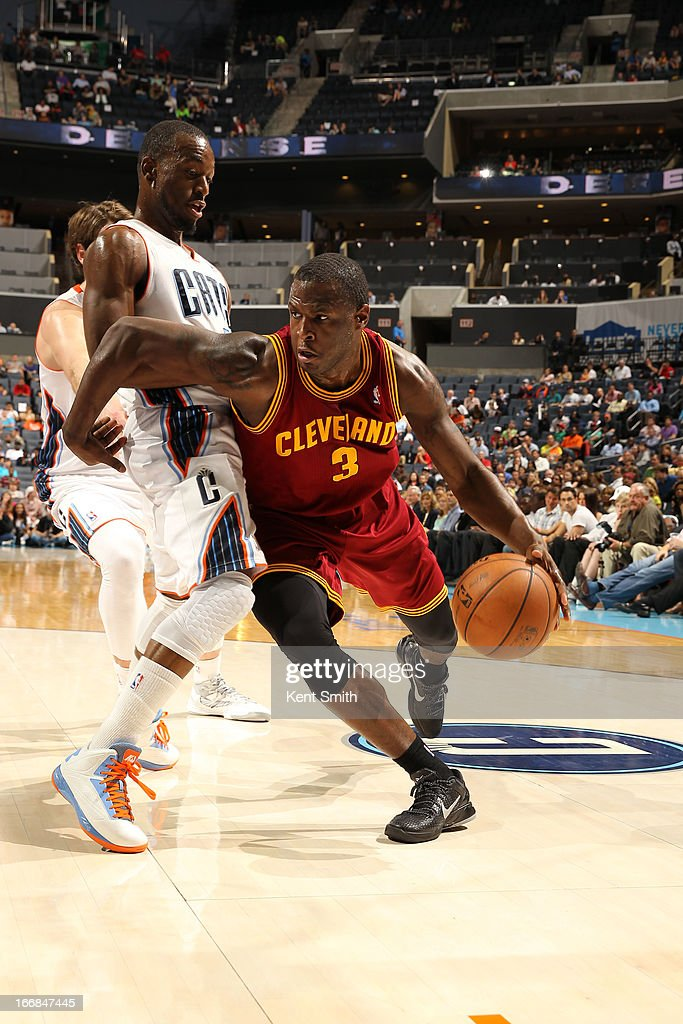 Dion Waiters #3 of the Cleveland Cavaliers drives against Kemba Walker #15 of the Charlotte Bobcats at the Time Warner Cable Arena on April 17, 2013 in Charlotte, North Carolina.
