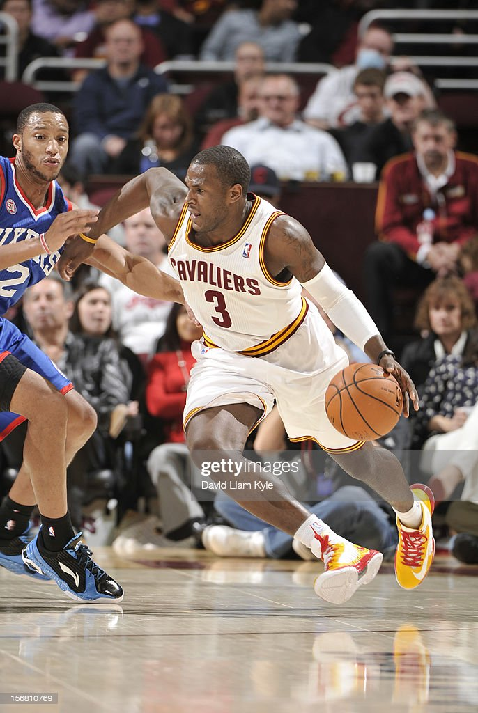 <a gi-track='captionPersonalityLinkClicked' href=/galleries/search?phrase=Dion+Waiters&family=editorial&specificpeople=6902921 ng-click='$event.stopPropagation()'>Dion Waiters</a> #3 of the Cleveland Cavaliers drives around the perimeter against <a gi-track='captionPersonalityLinkClicked' href=/galleries/search?phrase=Evan+Turner&family=editorial&specificpeople=4665764 ng-click='$event.stopPropagation()'>Evan Turner</a> #12 of the Philadelphia 76ers at The Quicken Loans Arena on November 21, 2012 in Cleveland, Ohio.