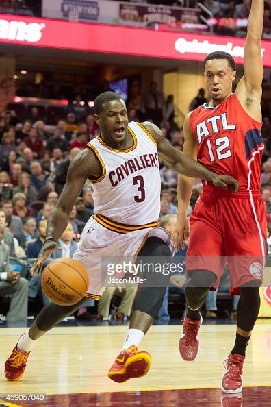 Dion Waiters of the Cleveland Cavaliers drives past John Jenkins of the Atlanta Hawks during the second half at Quicken Loans Arena on November 15...