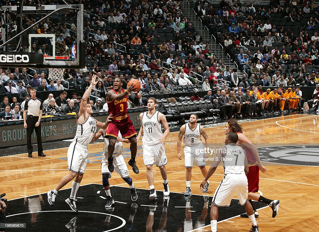 <a gi-track='captionPersonalityLinkClicked' href=/galleries/search?phrase=Dion+Waiters&family=editorial&specificpeople=6902921 ng-click='$event.stopPropagation()'>Dion Waiters</a> #3 of the Cleveland Cavaliers drives to the basket against <a gi-track='captionPersonalityLinkClicked' href=/galleries/search?phrase=Kris+Humphries&family=editorial&specificpeople=209199 ng-click='$event.stopPropagation()'>Kris Humphries</a> #43 of the Brooklyn Nets on November 13, 2012 at the Barclays Center in the Brooklyn Borough of New York City.
