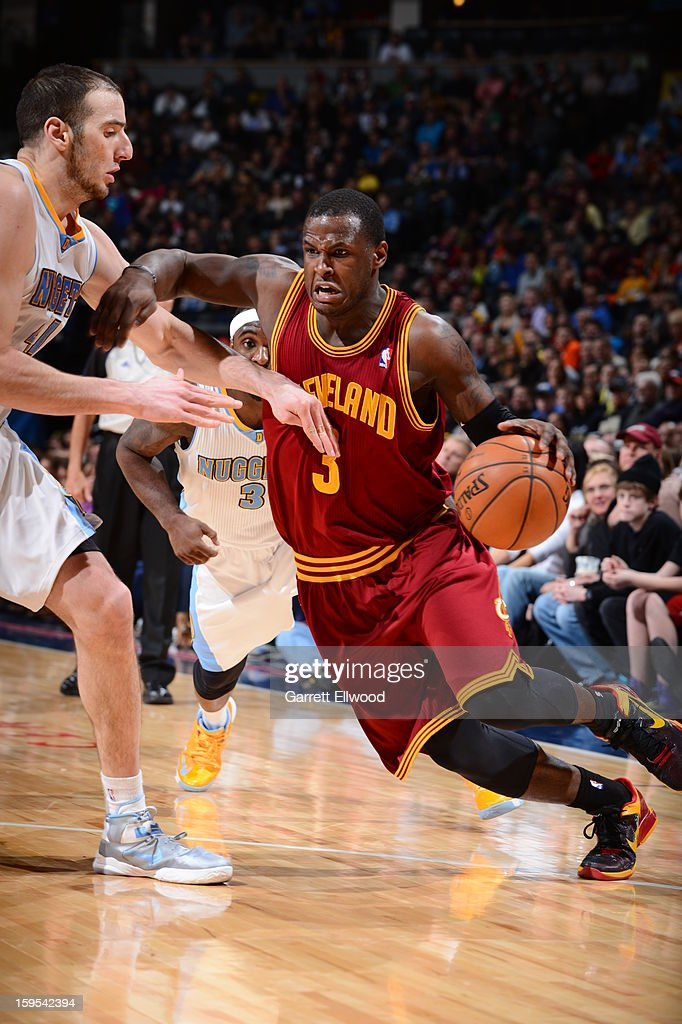 <a gi-track='captionPersonalityLinkClicked' href=/galleries/search?phrase=Dion+Waiters&family=editorial&specificpeople=6902921 ng-click='$event.stopPropagation()'>Dion Waiters</a> #3 of the Cleveland Cavaliers drives to the basket against the Denver Nuggets on January 11, 2013 at the Pepsi Center in Denver, Colorado.