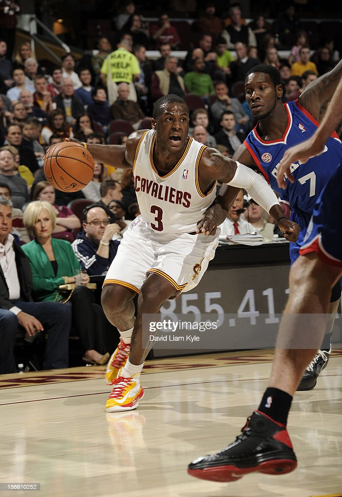 Dion Waiters #3 of the Cleveland Cavaliers drives to the hoop against Royal Ivey #7 of the Philadelphia 76ers at The Quicken Loans Arena on November 21, 2012 in Cleveland, Ohio.