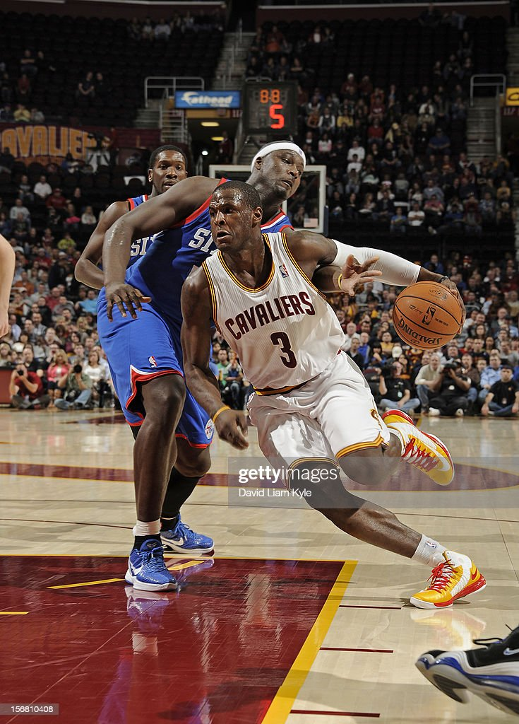 Dion Waiters #3 of the Cleveland Cavaliers drives to the hoop against Kwame Brown #54 of the Philadelphia 76ers at The Quicken Loans Arena on November 21, 2012 in Cleveland, Ohio.