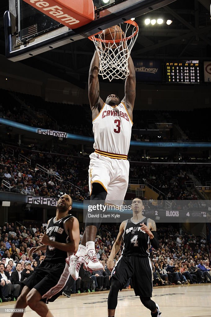 Dion Waiters #3 of the Cleveland Cavaliers dunks against Tony Parker #9 and Danny Green #4 of the San Antonio Spurs at The Quicken Loans Arena on February 13, 2013 in Cleveland, Ohio.