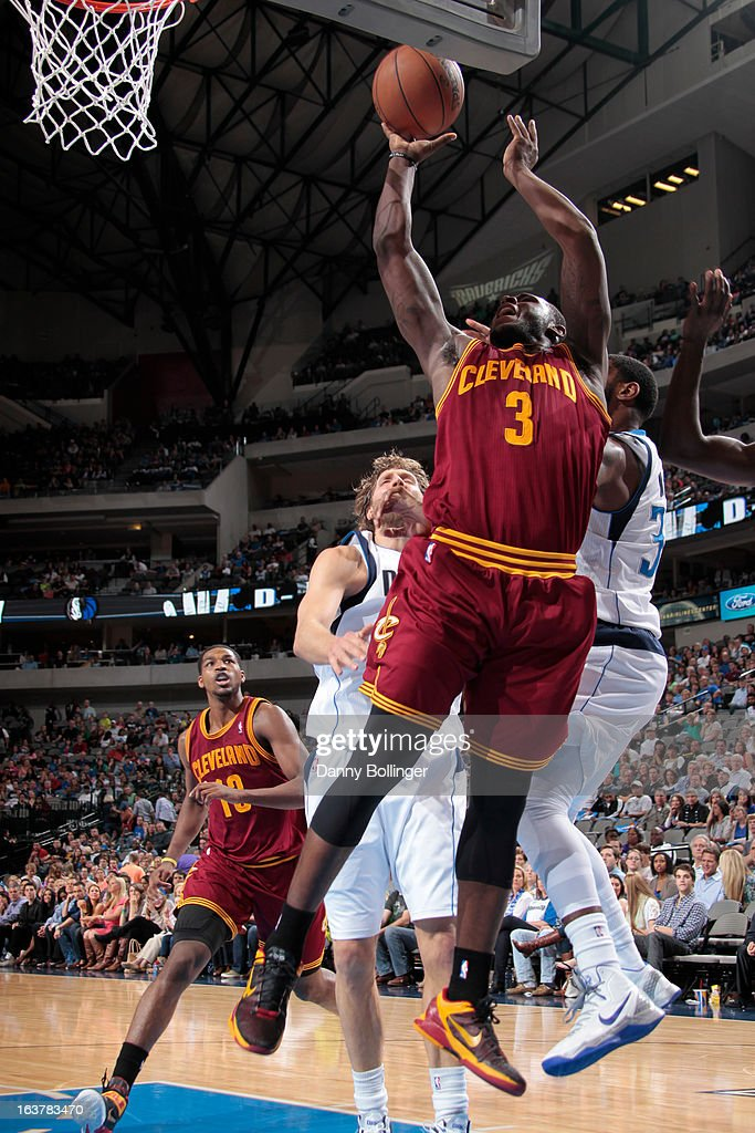 <a gi-track='captionPersonalityLinkClicked' href=/galleries/search?phrase=Dion+Waiters&family=editorial&specificpeople=6902921 ng-click='$event.stopPropagation()'>Dion Waiters</a> #3 of the Cleveland Cavaliers garbs a rebound against the Dallas Mavericks on March 15, 2013 at the American Airlines Center in Dallas, Texas.