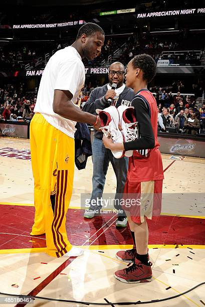 Dion Waiters of the Cleveland Cavaliers gives his shoes to a fan on Fan Appreciation Night after the game against the Brooklyn Nets at The Quicken...