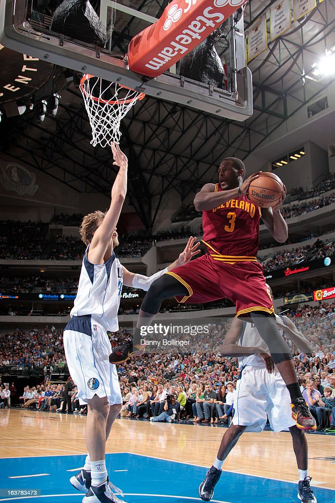 <a gi-track='captionPersonalityLinkClicked' href=/galleries/search?phrase=Dion+Waiters&family=editorial&specificpeople=6902921 ng-click='$event.stopPropagation()'>Dion Waiters</a> #3 of the Cleveland Cavaliers goes to the basket against <a gi-track='captionPersonalityLinkClicked' href=/galleries/search?phrase=Dirk+Nowitzki&family=editorial&specificpeople=201490 ng-click='$event.stopPropagation()'>Dirk Nowitzki</a> #41 and the Dallas Mavericks on March 15, 2013 at the American Airlines Center in Dallas, Texas.