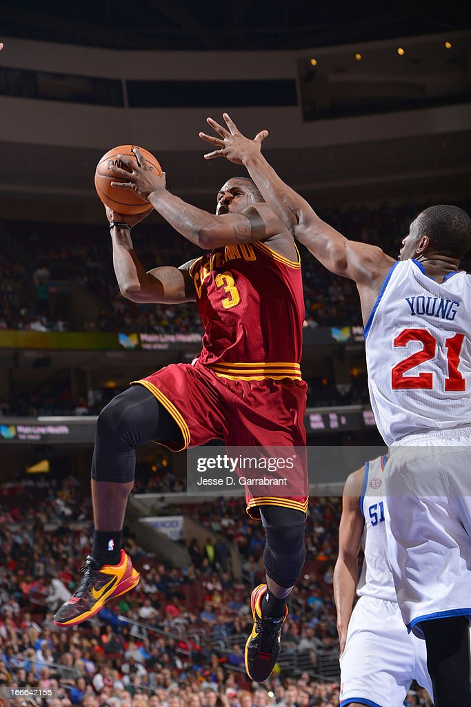 Dion Waiters #3 of the Cleveland Cavaliers goes to the basket against Thaddeus Young #21 of the Philadelphia 76ers at the Wells Fargo Center on April 14, 2013 in Philadelphia, Pennsylvania.