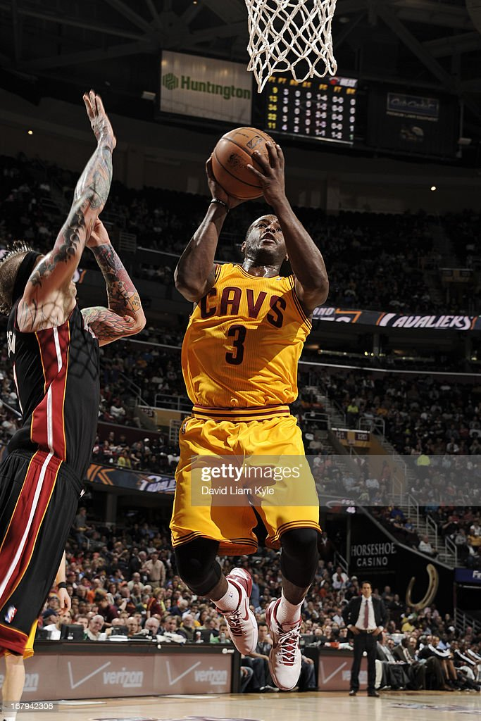 Dion Waiters #3 of the Cleveland Cavaliers goes to the basket against Chris Andersen #11 of the Miami Heat at The Quicken Loans Arena on April 15, 2013 in Cleveland, Ohio.