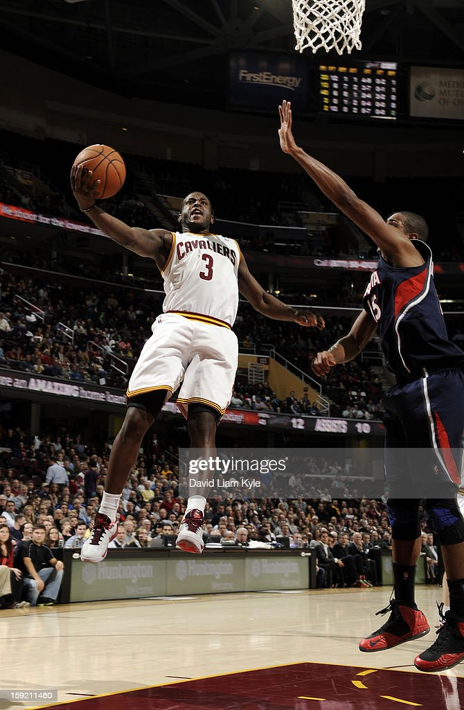 Dion Waiters #3 of the Cleveland Cavaliers goes up for the shot against Al Horford #15 of the Atlanta Hawks at The Quicken Loans Arena on January 9, 2013 in Cleveland, Ohio.