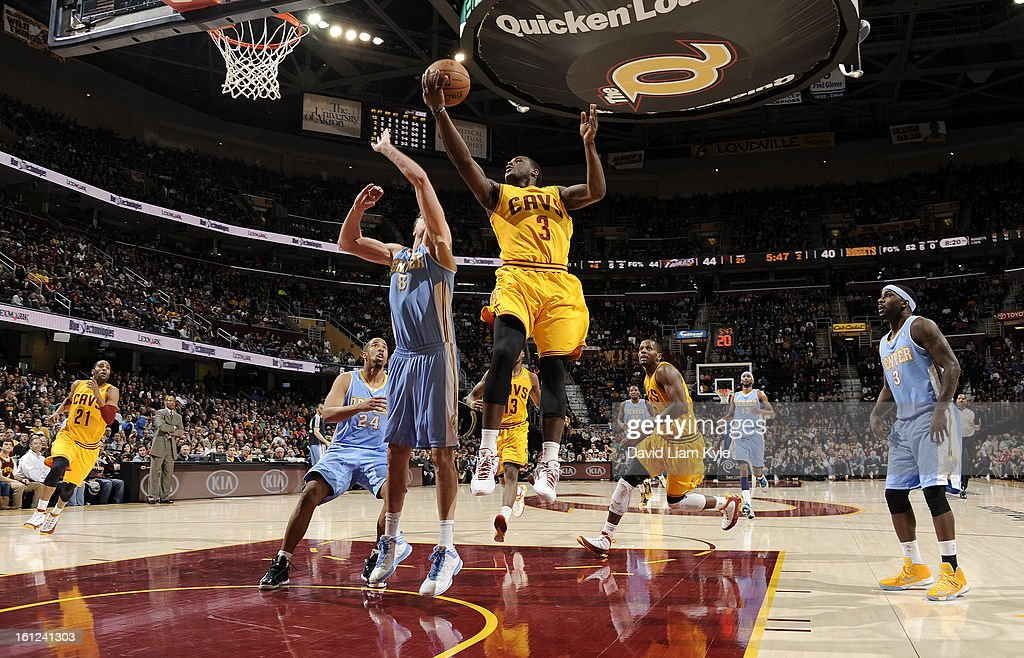 Dion Waiters #3 of the Cleveland Cavaliers goes up for the shot against Danilo Gallinari #8 of the Denver Nuggets at The Quicken Loans Arena on February 9, 2013 in Cleveland, Ohio.
