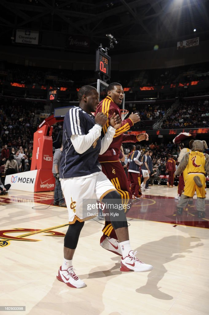 <a gi-track='captionPersonalityLinkClicked' href=/galleries/search?phrase=Dion+Waiters&family=editorial&specificpeople=6902921 ng-click='$event.stopPropagation()'>Dion Waiters</a> #3 of the Cleveland Cavaliers greets teammate <a gi-track='captionPersonalityLinkClicked' href=/galleries/search?phrase=Alonzo+Gee&family=editorial&specificpeople=801443 ng-click='$event.stopPropagation()'>Alonzo Gee</a> #33 before the game against the San Antonio Spurs at The Quicken Loans Arena on February 13, 2013 in Cleveland, Ohio.