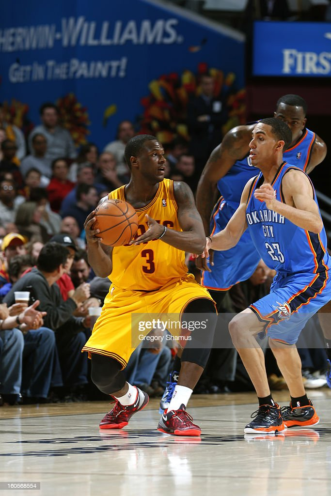 Dion Waiters #3 of the Cleveland Cavaliers looks to pass the ball against Kevin Martin #23 of the Oklahoma City Thunder at The Quicken Loans Arena on February 2, 2013 in Cleveland, Ohio.