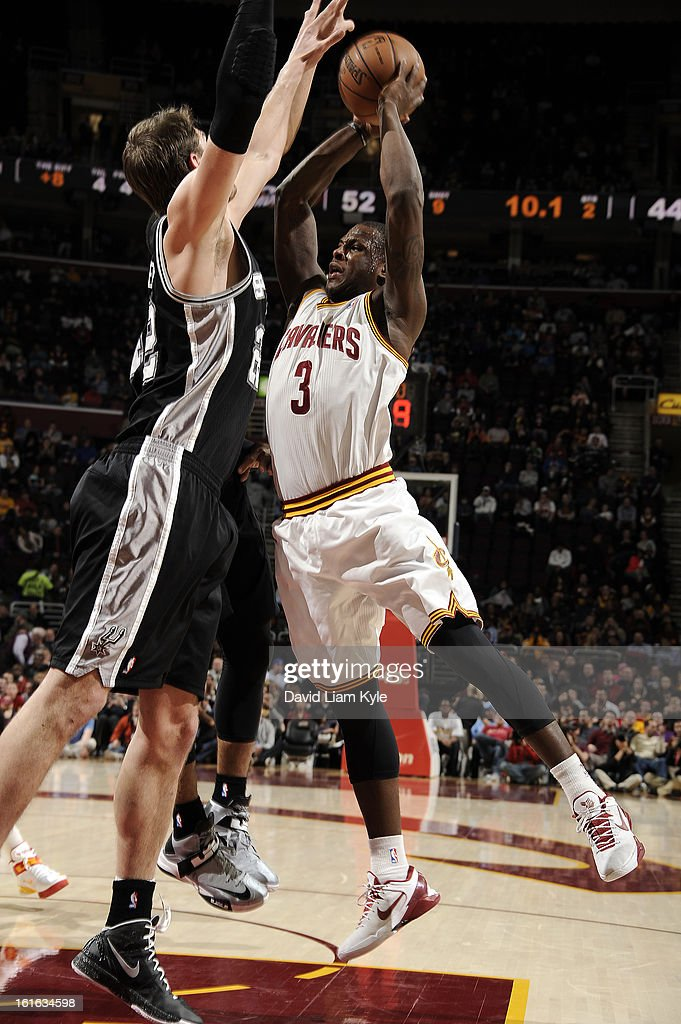 Dion Waiters #3 of the Cleveland Cavaliers passes the ball against Tiago Splitter #22 of the San Antonio Spurs at The Quicken Loans Arena on February 13, 2013 in Cleveland, Ohio.
