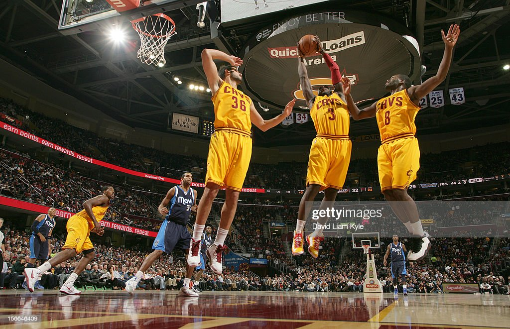 <a gi-track='captionPersonalityLinkClicked' href=/galleries/search?phrase=Dion+Waiters&family=editorial&specificpeople=6902921 ng-click='$event.stopPropagation()'>Dion Waiters</a> #3 of the Cleveland Cavaliers pulls down the rebound alongside teammates <a gi-track='captionPersonalityLinkClicked' href=/galleries/search?phrase=Omri+Casspi&family=editorial&specificpeople=2298404 ng-click='$event.stopPropagation()'>Omri Casspi</a> #36 and <a gi-track='captionPersonalityLinkClicked' href=/galleries/search?phrase=Jeremy+Pargo&family=editorial&specificpeople=732443 ng-click='$event.stopPropagation()'>Jeremy Pargo</a> #8 in the game against the Dallas Mavericks at The Quicken Loans Arena on November 17, 2012 in Cleveland, Ohio.