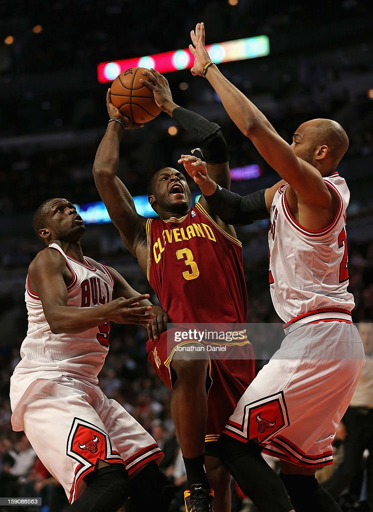 <a gi-track='captionPersonalityLinkClicked' href=/galleries/search?phrase=Dion+Waiters&family=editorial&specificpeople=6902921 ng-click='$event.stopPropagation()'>Dion Waiters</a> #3 of the Cleveland Cavaliers puts up a shot between Loul Deng #9 and <a gi-track='captionPersonalityLinkClicked' href=/galleries/search?phrase=Taj+Gibson&family=editorial&specificpeople=4029461 ng-click='$event.stopPropagation()'>Taj Gibson</a> #22 of the Chicago Bulls at the United Center on January 7, 2013 in Chicago, Illinois.