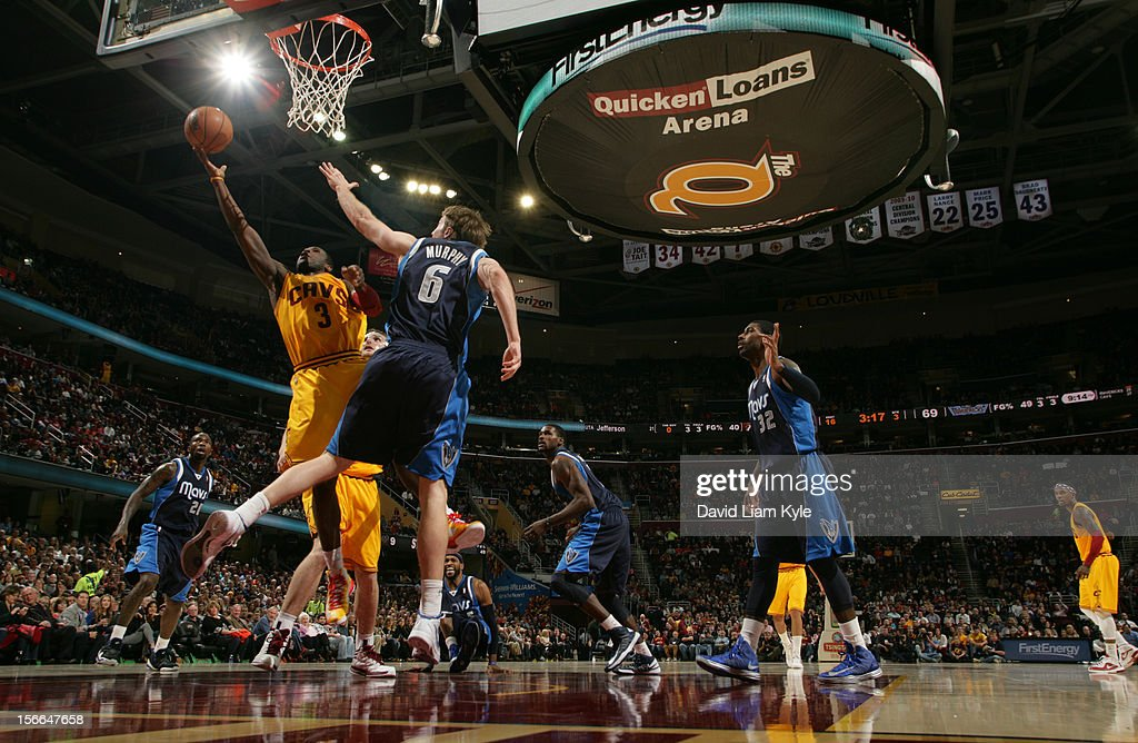 <a gi-track='captionPersonalityLinkClicked' href=/galleries/search?phrase=Dion+Waiters&family=editorial&specificpeople=6902921 ng-click='$event.stopPropagation()'>Dion Waiters</a> #3 of the Cleveland Cavaliers puts up the shot against <a gi-track='captionPersonalityLinkClicked' href=/galleries/search?phrase=Troy+Murphy&family=editorial&specificpeople=201794 ng-click='$event.stopPropagation()'>Troy Murphy</a> #6 of the Dallas Mavericks at The Quicken Loans Arena on November 17, 2012 in Cleveland, Ohio.