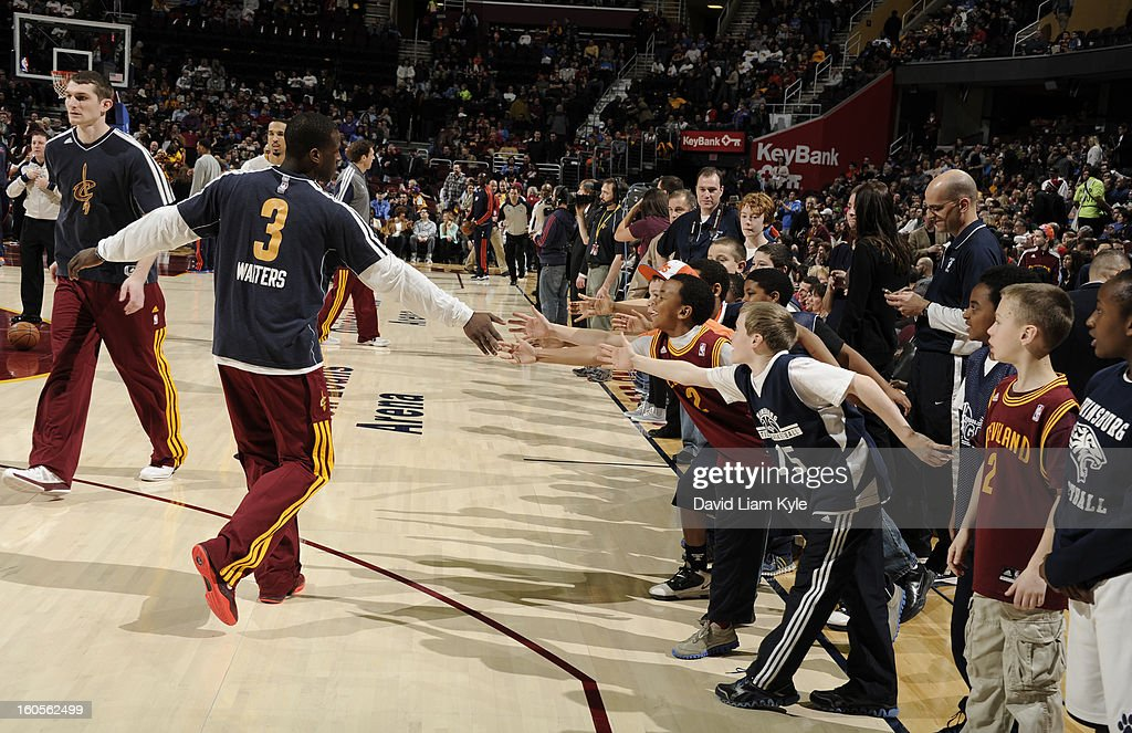 Dion Waiters #3 of the Cleveland Cavaliers shakes hands with some young fans prior to the game against the Oklahoma City Thunder at The Quicken Loans Arena on February 2, 2013 in Cleveland, Ohio.