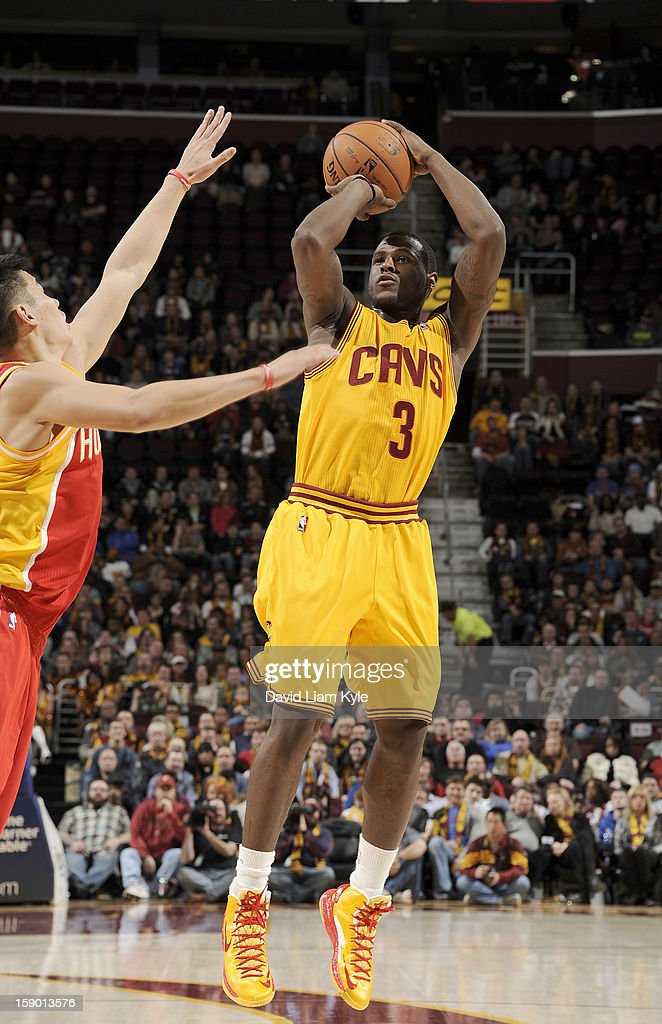<a gi-track='captionPersonalityLinkClicked' href=/galleries/search?phrase=Dion+Waiters&family=editorial&specificpeople=6902921 ng-click='$event.stopPropagation()'>Dion Waiters</a> #3 of the Cleveland Cavaliers shoots a jumper against Jeremy Lin #7 of the Houston Rockets at The Quicken Loans Arena on January 5, 2013 in Cleveland, Ohio.