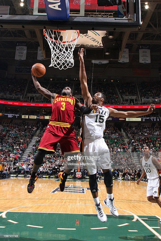 Dion Waiters #3 of the Cleveland Cavaliers shoots against Derrick Favors #15 of the Utah Jazz at Energy Solutions Arena on January 19, 2013 in Salt Lake City, Utah.