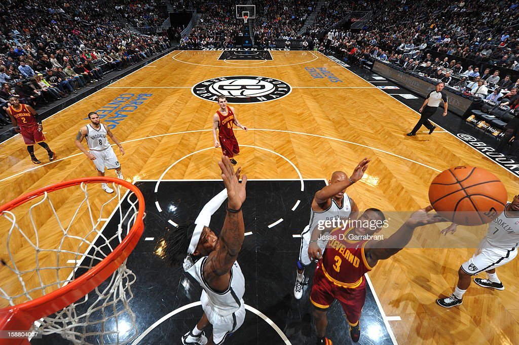 Dion Waiters #3 of the Cleveland Cavaliers shoots against Gerald Wallace #45 of the Brooklyn Nets during the game at the Barclays Center on December 29, 2012 in Brooklyn, New York.