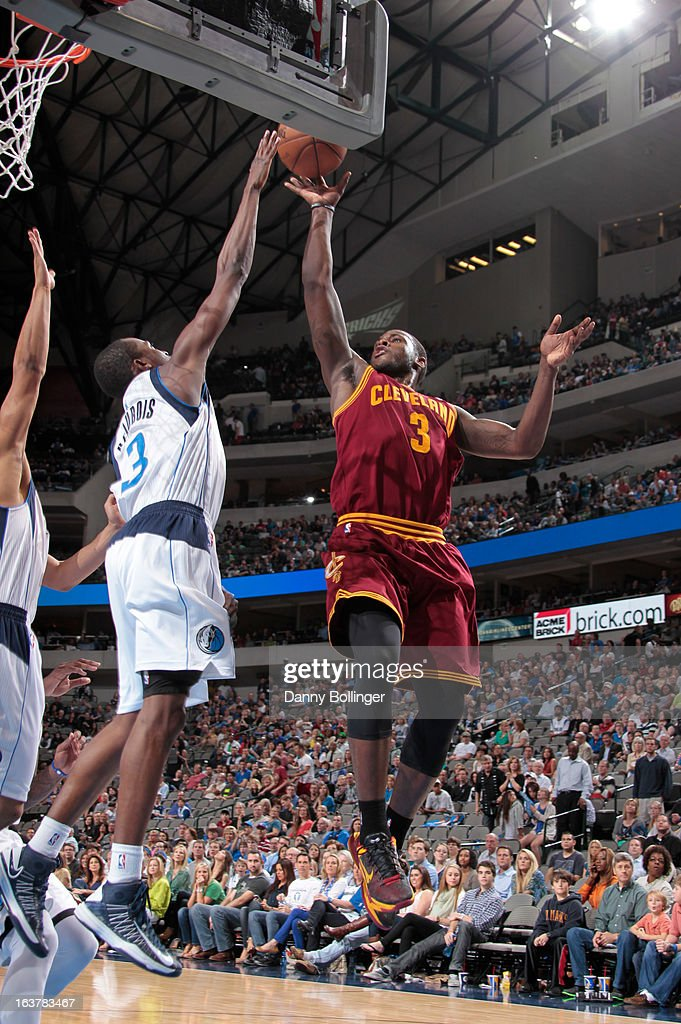 <a gi-track='captionPersonalityLinkClicked' href=/galleries/search?phrase=Dion+Waiters&family=editorial&specificpeople=6902921 ng-click='$event.stopPropagation()'>Dion Waiters</a> #3 of the Cleveland Cavaliers shoots against <a gi-track='captionPersonalityLinkClicked' href=/galleries/search?phrase=Rodrigue+Beaubois&family=editorial&specificpeople=5299423 ng-click='$event.stopPropagation()'>Rodrigue Beaubois</a> #3 of the Dallas Mavericks on March 15, 2013 at the American Airlines Center in Dallas, Texas.