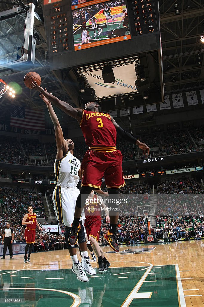 Dion Waiters #3 of the Cleveland Cavaliers steals the rebound against Derrick Favors #15 of the Utah Jazz at Energy Solutions Arena on January 19, 2013 in Salt Lake City, Utah.