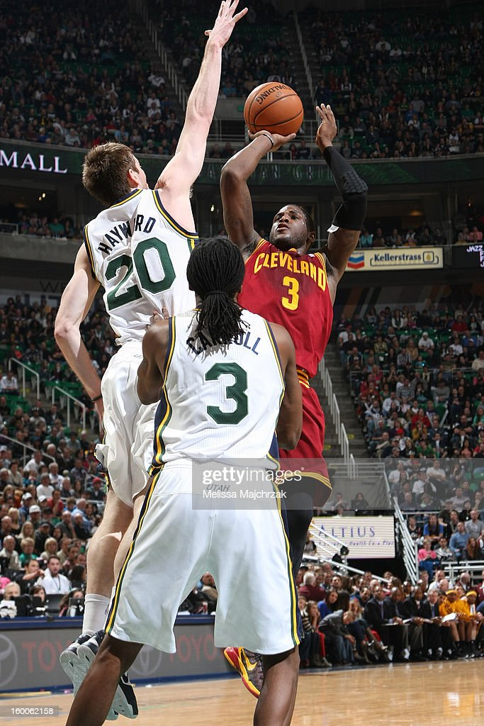 <a gi-track='captionPersonalityLinkClicked' href=/galleries/search?phrase=Dion+Waiters&family=editorial&specificpeople=6902921 ng-click='$event.stopPropagation()'>Dion Waiters</a> #3 of the Cleveland Cavaliers takes a shot over <a gi-track='captionPersonalityLinkClicked' href=/galleries/search?phrase=Gordon+Hayward&family=editorial&specificpeople=5767271 ng-click='$event.stopPropagation()'>Gordon Hayward</a> #20 of the Utah Jazz on January 19, 2013 in Salt Lake City, Utah.