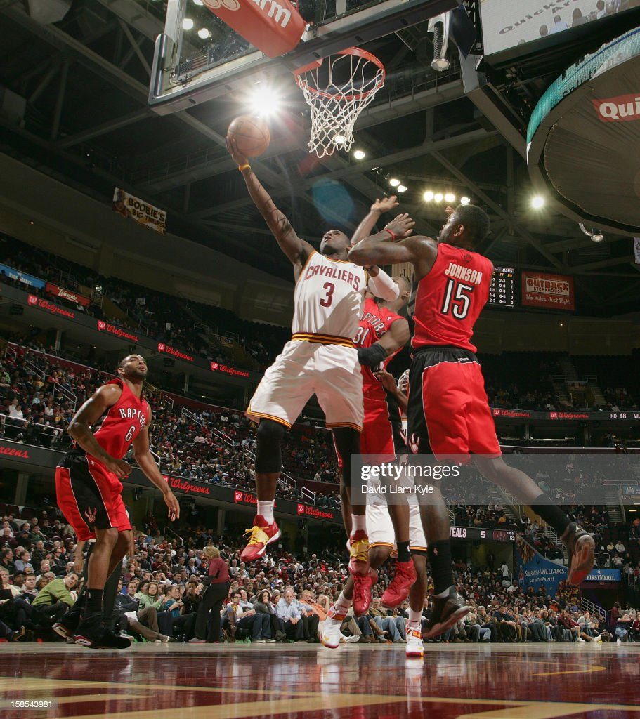 <a gi-track='captionPersonalityLinkClicked' href=/galleries/search?phrase=Dion+Waiters&family=editorial&specificpeople=6902921 ng-click='$event.stopPropagation()'>Dion Waiters</a> #3 of the Cleveland Cavaliers tosses up the shot against <a gi-track='captionPersonalityLinkClicked' href=/galleries/search?phrase=Alan+Anderson&family=editorial&specificpeople=3945355 ng-click='$event.stopPropagation()'>Alan Anderson</a> #6, <a gi-track='captionPersonalityLinkClicked' href=/galleries/search?phrase=Terrence+Ross&family=editorial&specificpeople=6781663 ng-click='$event.stopPropagation()'>Terrence Ross</a> #31 and <a gi-track='captionPersonalityLinkClicked' href=/galleries/search?phrase=Amir+Johnson&family=editorial&specificpeople=556786 ng-click='$event.stopPropagation()'>Amir Johnson</a> #15 of the Toronto Raptors at The Quicken Loans Arena on December 18, 2012 in Cleveland, Ohio.