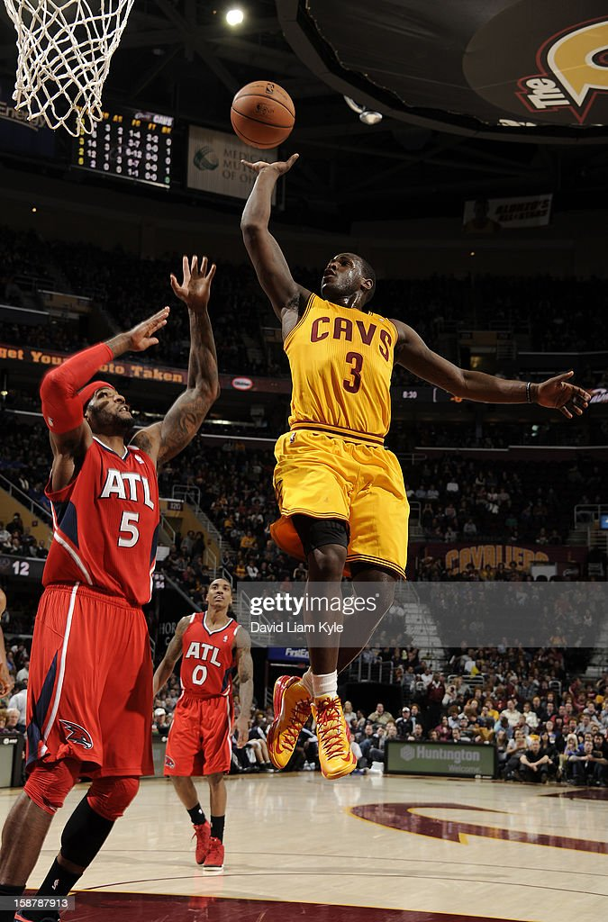 Dion Waiters #3 of the Cleveland Cavaliers tosses up the shot against Josh Smith #5 of the Atlanta Hawks at The Quicken Loans Arena on December 28, 2012 in Cleveland, Ohio.