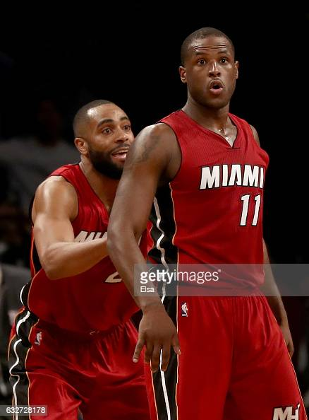 Dion Waiters of the Miami Heat celebrates his three point shot in the final minutes of the game with teammate Wayne Ellington in the fourth quarter...