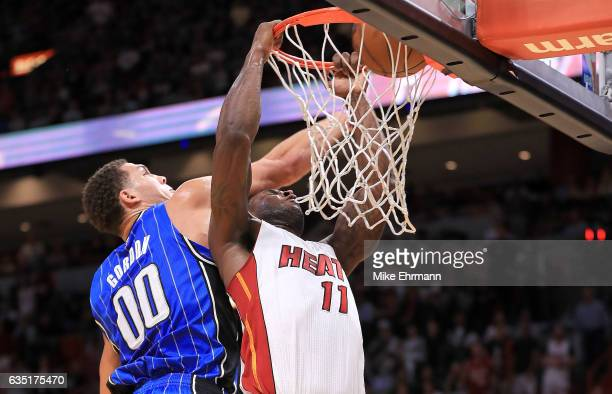 Dion Waiters of the Miami Heat dunks on Aaron Gordon of the Orlando Magic during a game at American Airlines Arena on February 13 2017 in Miami...