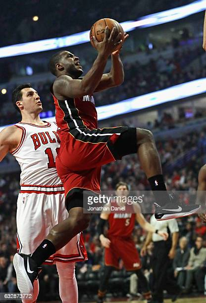 Dion Waiters of the Miami Heat goes up for a shot past Paul Zipser of the Chicago Bulls at the United Center on January 27 2017 in Chicago Illinois...