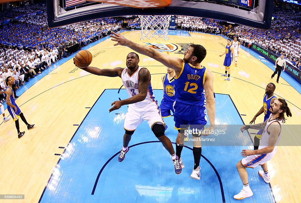 Dion Waiters #3 of the Oklahoma City Thunder goes up against Andrew Bogut #12 of the Golden State Warriors in the first half in game three of the Western Conference Finals during the 2016 NBA Playoffs at Chesapeake Energy Arena on May 22, 2016 in Oklahoma City, Oklahoma.