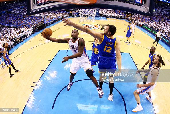 Dion Waiters of the Oklahoma City Thunder goes up against Andrew Bogut of the Golden State Warriors in the first half in game three of the Western...