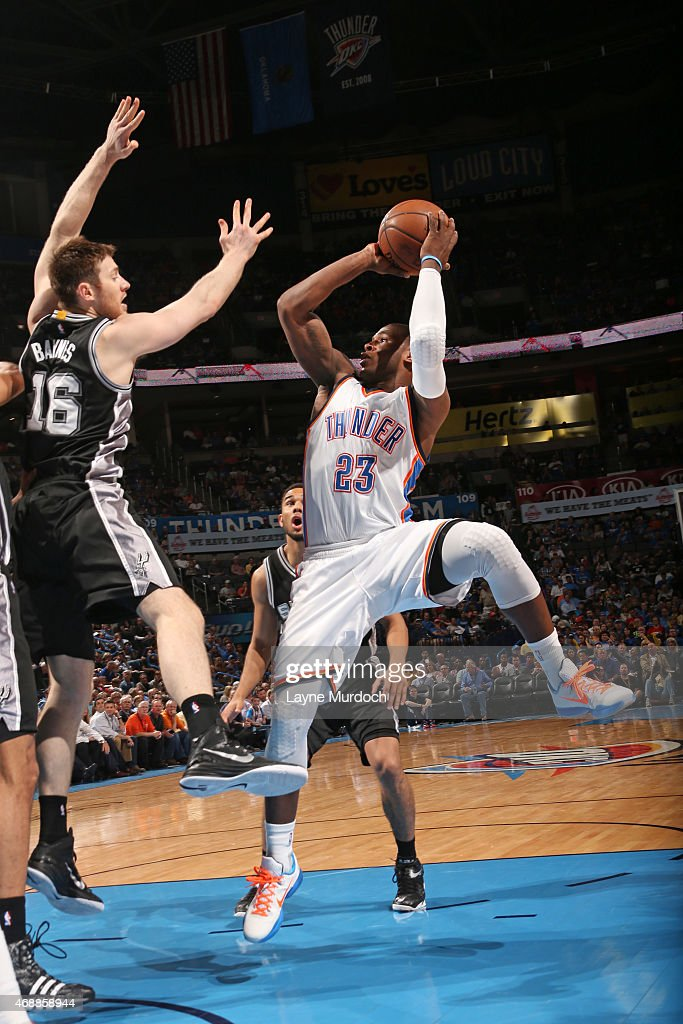 Dion Waiters #23 of the Oklahoma City Thunder shoots the ball against the San Antonio Spurs on April 7, 2015 at Chesapeake Energy Arena in Oklahoma City, Oklahoma.
