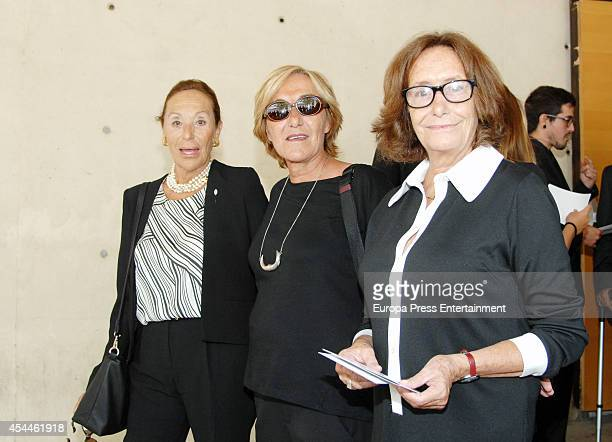 Dione Pertegaz Elisa Pertegaz and Sionin Pertegaz attend the funeral for the Spanish designer Manuel Pertegaz on August 31 2014 in Barcelona Spain