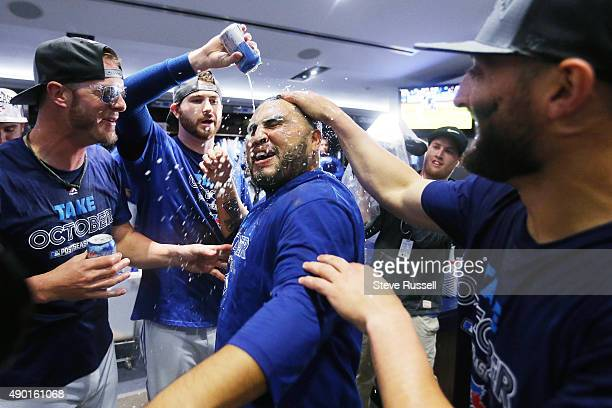TORONTO ON SEPTEMBER 26 Dioner Navarro gets a beer shower as the playoff bound Toronto Blue Jays celebrate in their clubhouse after beating the Tampa...