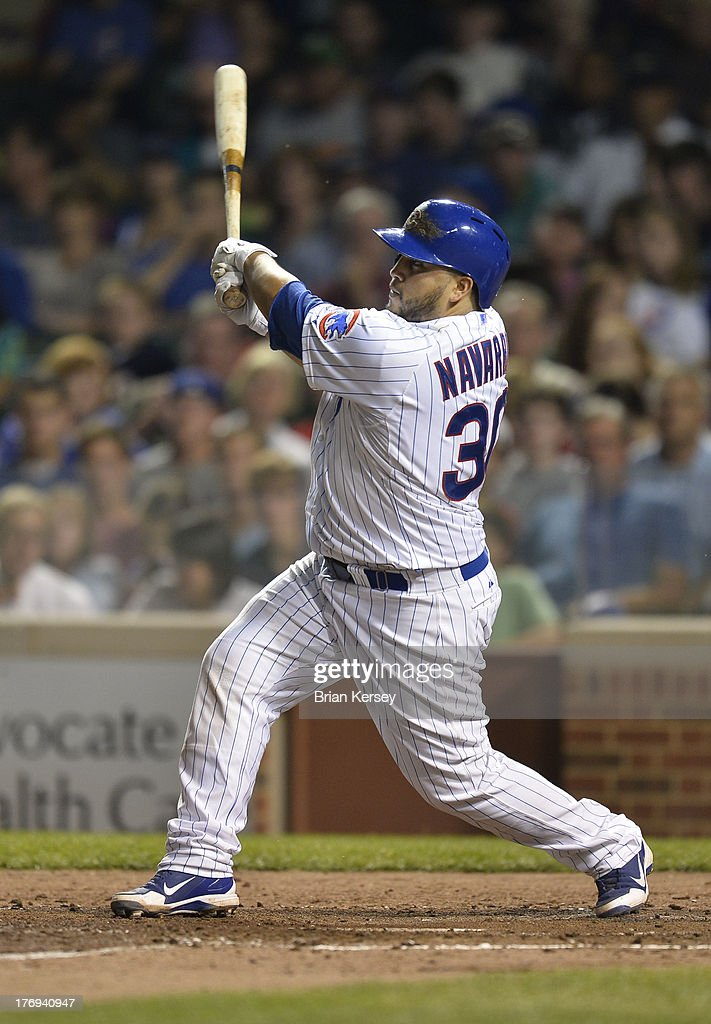 <a gi-track='captionPersonalityLinkClicked' href=/galleries/search?phrase=Dioner+Navarro&family=editorial&specificpeople=593062 ng-click='$event.stopPropagation()'>Dioner Navarro</a> #30 of the Chicago Cubs follows through on a three-run home run scoring teammates Junior Lake #21 and Darwin Barney #15 during the fifth inning against the Washington Nationals at Wrigley Field on August 19, 2013 in Chicago, Illinois.