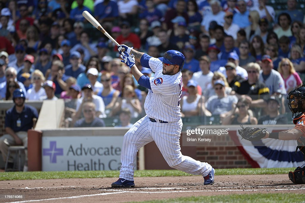 <a gi-track='captionPersonalityLinkClicked' href=/galleries/search?phrase=Dioner+Navarro&family=editorial&specificpeople=593062 ng-click='$event.stopPropagation()'>Dioner Navarro</a> #30 of the Chicago Cubs follows through on an RBI single scoring Luis Valbuena #24 during the first inning against the Miami Marlins at Wrigley Field on September 2, 2013 in Chicago, Illinois.