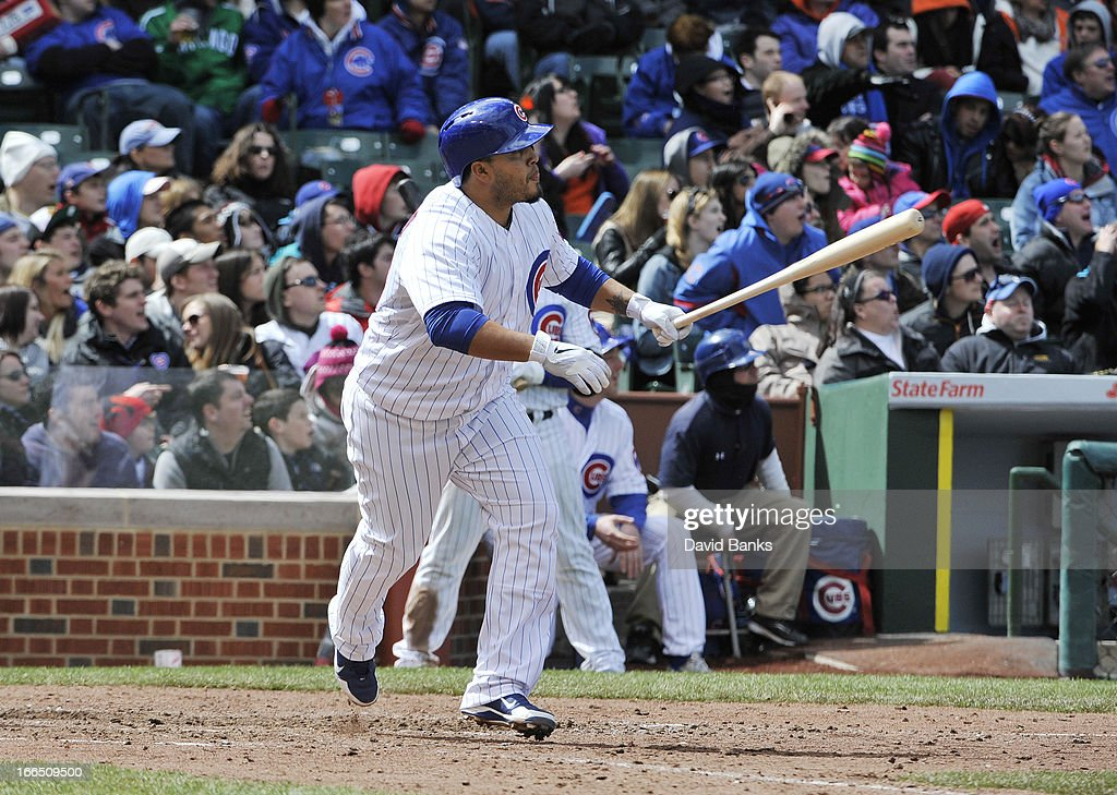 <a gi-track='captionPersonalityLinkClicked' href=/galleries/search?phrase=Dioner+Navarro&family=editorial&specificpeople=593062 ng-click='$event.stopPropagation()'>Dioner Navarro</a> #30 of the Chicago Cubs hits a two-run homer during the seventh inning against the San Francisco Giants on April 13, 2013 at Wrigley Field in Chicago, Illinois.