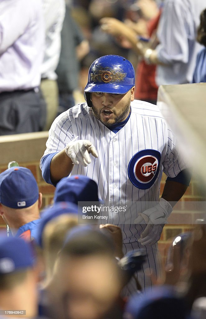 <a gi-track='captionPersonalityLinkClicked' href=/galleries/search?phrase=Dioner+Navarro&family=editorial&specificpeople=593062 ng-click='$event.stopPropagation()'>Dioner Navarro</a> #30 of the Chicago Cubs is congratulated by his teammates after hitting a three-run home run scoring Darwin Barney #15 and Junior Lake #21 during the fifth inning against the Washington Nationals at Wrigley Field on August 19, 2013 in Chicago, Illinois.