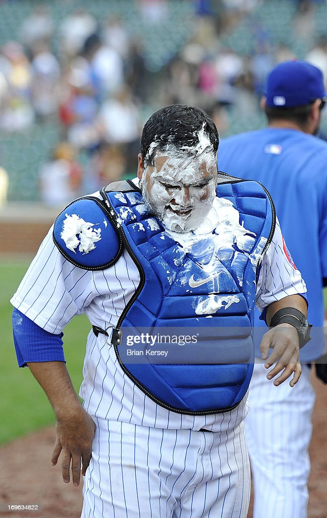 Dioner Navarro #30 of the Chicago Cubs is covered in shaving cream during his post game interview after the game against the Chicago White Sox at Wrigley Field on May 29, 2013 in Chicago, Illinois. Navarro hit three home runs in the game as the Cubs defeated the White Sox 9-3.