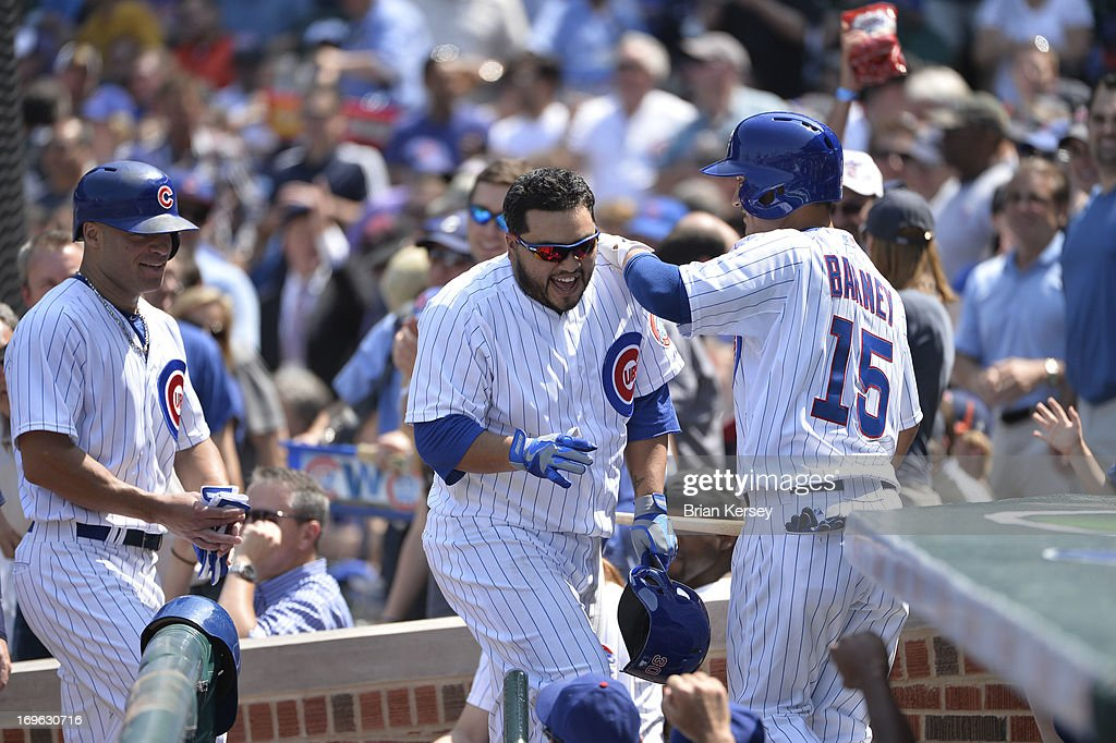 <a gi-track='captionPersonalityLinkClicked' href=/galleries/search?phrase=Dioner+Navarro&family=editorial&specificpeople=593062 ng-click='$event.stopPropagation()'>Dioner Navarro</a> #30 of the Chicago Cubs (C) is greeted at the dugout by teammate <a gi-track='captionPersonalityLinkClicked' href=/galleries/search?phrase=Darwin+Barney&family=editorial&specificpeople=537975 ng-click='$event.stopPropagation()'>Darwin Barney</a> #15 after hitting a two-run home run scoring <a gi-track='captionPersonalityLinkClicked' href=/galleries/search?phrase=Scott+Hairston&family=editorial&specificpeople=836506 ng-click='$event.stopPropagation()'>Scott Hairston</a> #21 (L) during the fourth inning against the Chicago White Sox at Wrigley Field on May 29, 2013 in Chicago, Illinois.