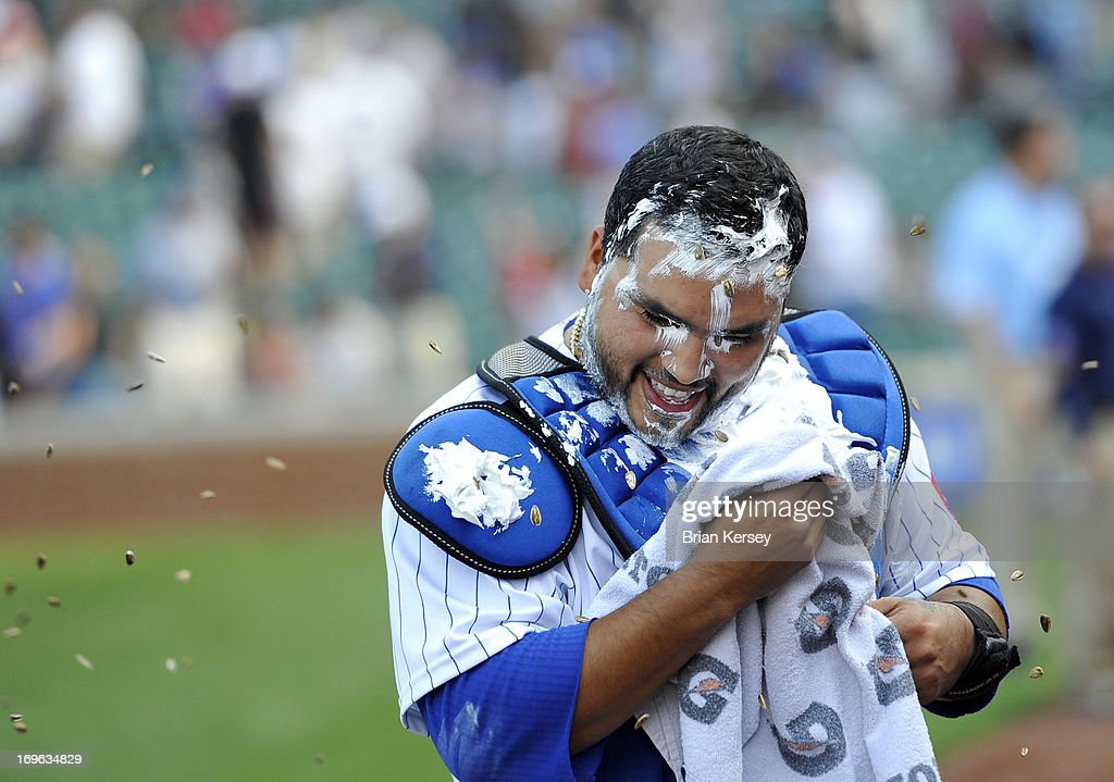 Dioner Navarro #30 of the Chicago Cubs is pelted with sunflower seeds after he was drenched with water and covered in shaving cream during his post game interview after the game against the Chicago White Sox at Wrigley Field on May 29, 2013 in Chicago, Illinois. Navarro hit three home runs in the game as the Cubs defeated the White Sox 9-3.