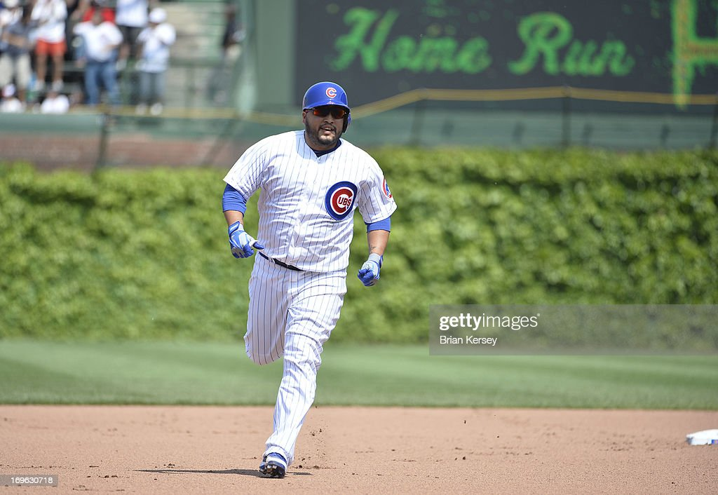 <a gi-track='captionPersonalityLinkClicked' href=/galleries/search?phrase=Dioner+Navarro&family=editorial&specificpeople=593062 ng-click='$event.stopPropagation()'>Dioner Navarro</a> #30 of the Chicago Cubs rounds the bases after hitting a two-run home run scoring Scott Hairston #21 during the fourth inning against the Chicago White Sox at Wrigley Field on May 29, 2013 in Chicago, Illinois.