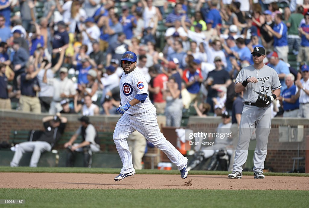 Dioner Navarro #30 of the Chicago Cubs rounds the bases after hitting a three-run home run scoring teammates Alfonso Soriano #12 and Anthony Rizzo #44 during the seventh inning against the Chicago White Sox at Wrigley Field on May 29, 2013 in Chicago, Illinois. The home run was Navarro's third of the game.